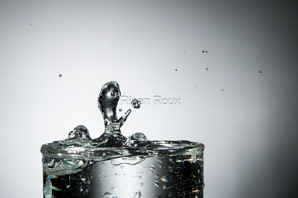 Water Splash into Glass by Riaan Roux
