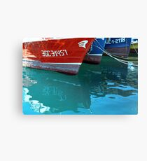 Reflection of red and blue Boats Canvas Print