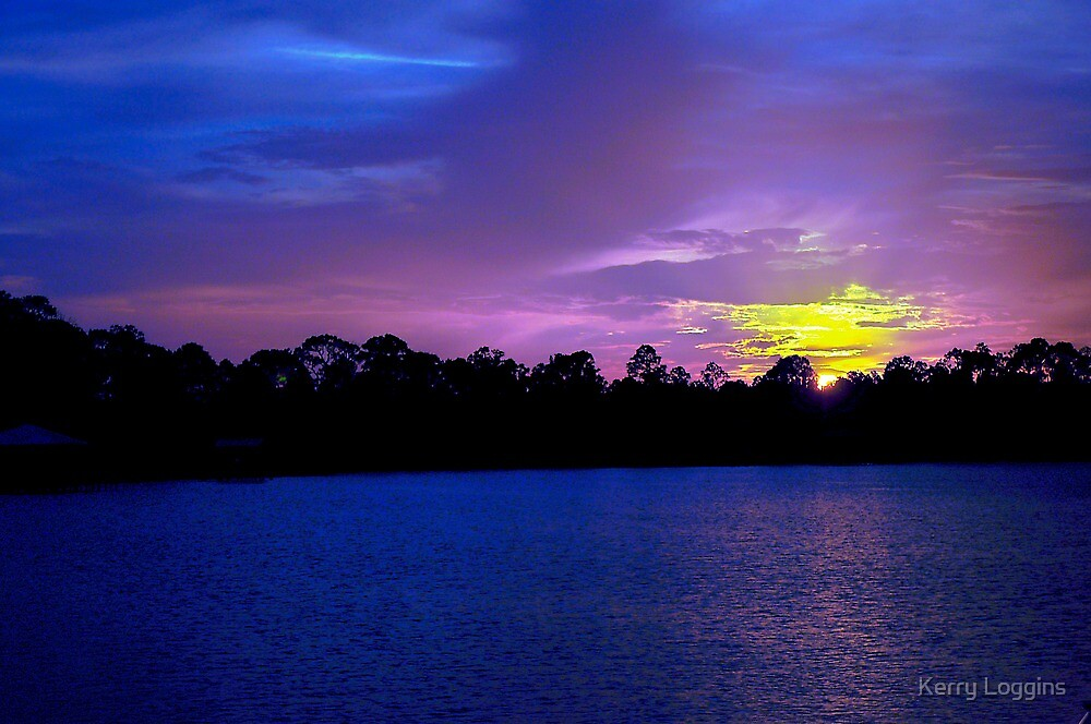 Sunset on the lake by Kerry Loggins