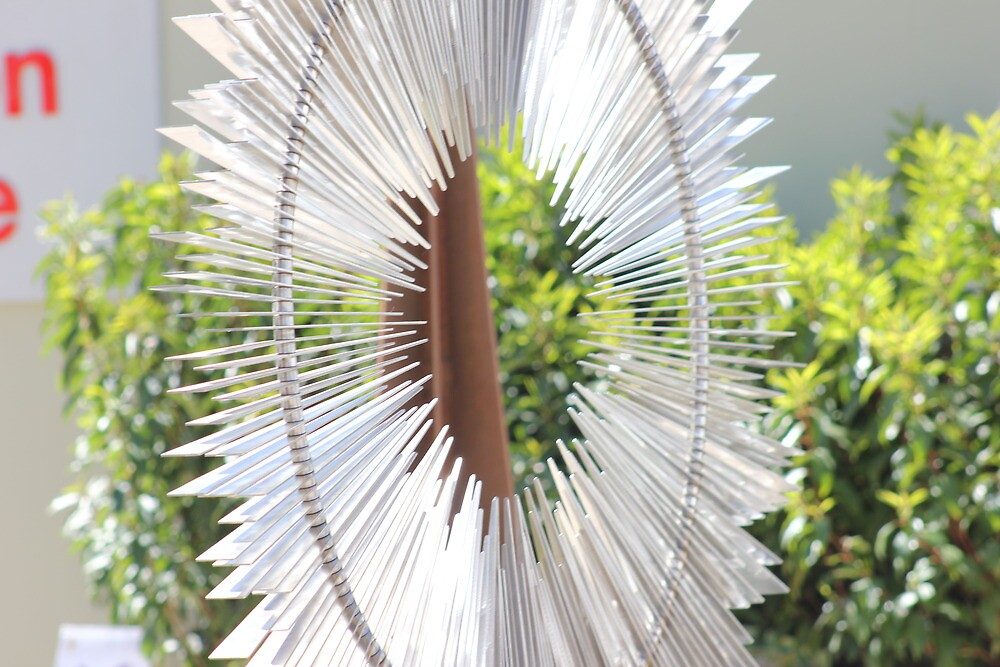 Silver spike circle by Aaron  Wahab