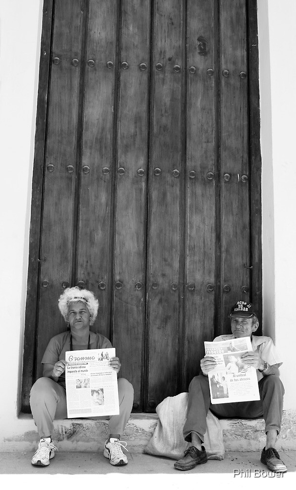 Cuban newspaper sellers. by Phil Bower