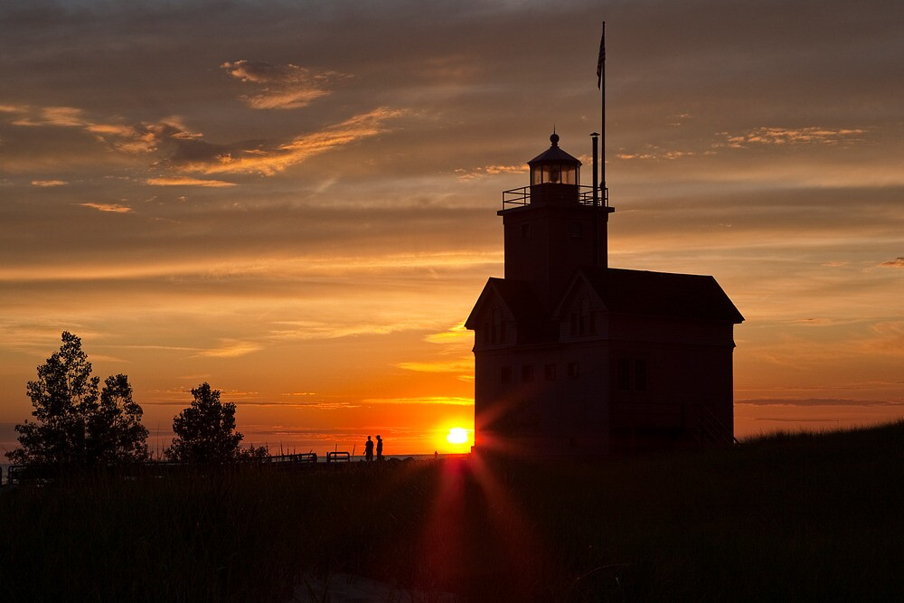 Big Red Lighthouse at Sunset by Randall Nyhof
