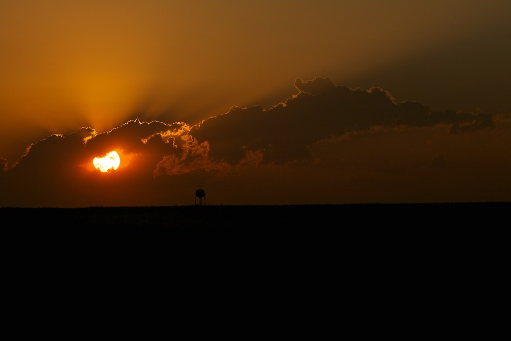 Sunset on the Plains by Rick Louie