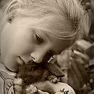 Bunny cuddles by Karen Tregoning
