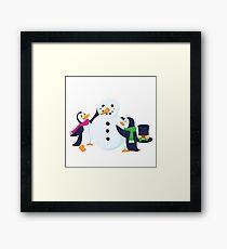 Snowman penguins Framed Print