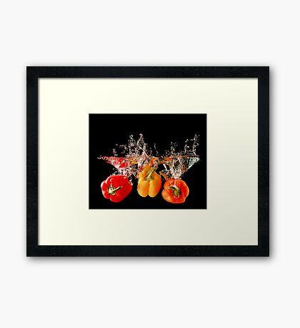 A Splash Of Peppers Framed Print