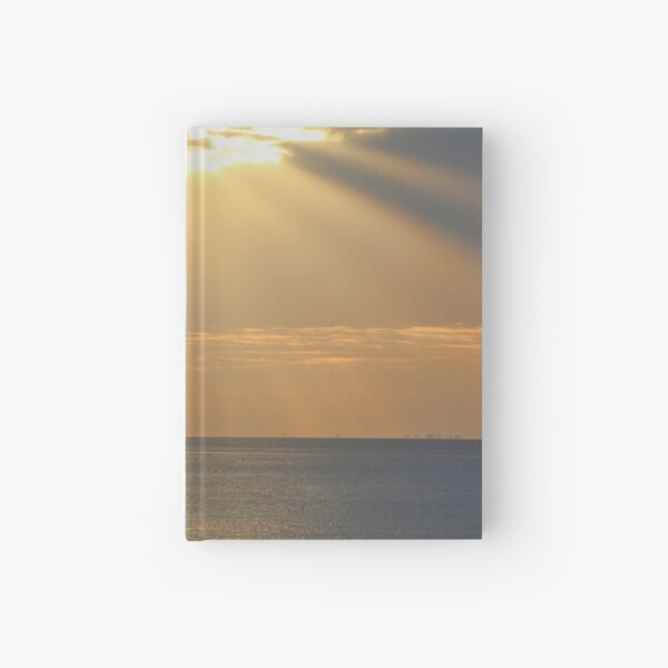 Sunset over the sea Hardcover Journal