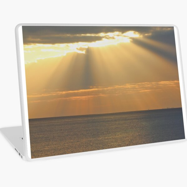 Sunset over the sea Laptop Skin
