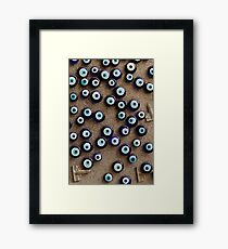 With so many eyes it's hard to focus Framed Print