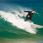 Style and grace on a wave by Scott Weeding