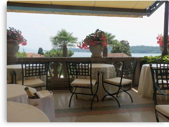"THE PEARL OF LAKE GARDA ...SALO' .Italy - Europe -"" tables and Chairs a Veranda on Lake Garda -RB EXPLORE VETRINA 20 LUGLIO 2012 --           by Guendalyn"