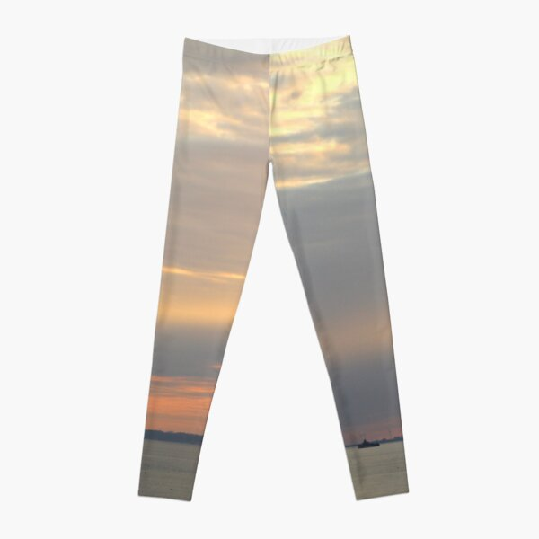 Sunset over the sea Leggings