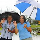 Out with the umbrellas after Cyclone Yassi by myhobby