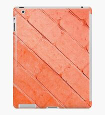 Red background of bricks on a diagonal image with a layer of paint iPad Case/Skin