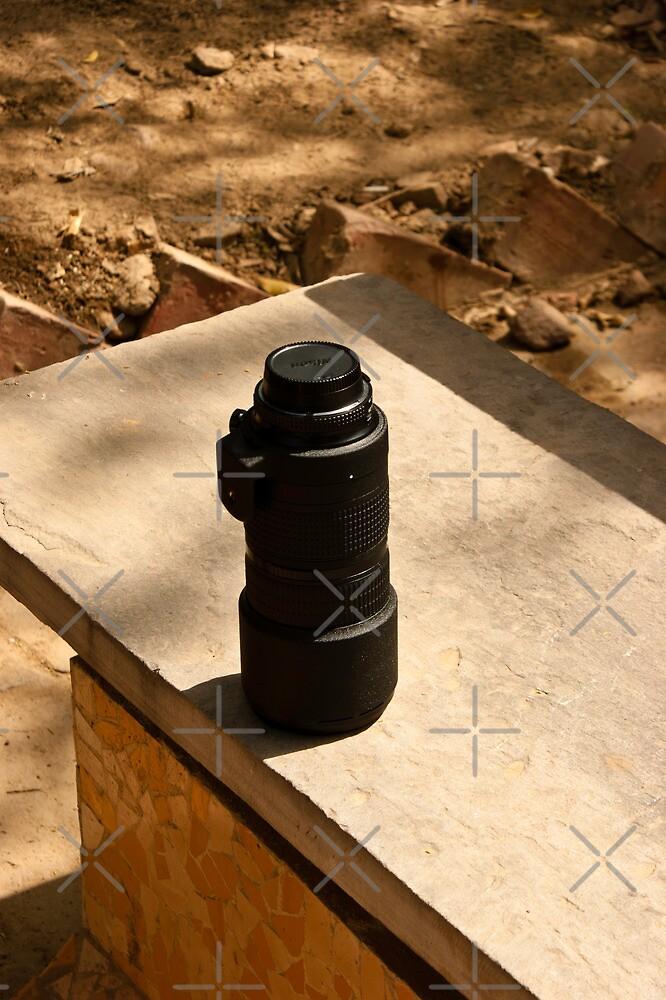 Nikon zoom lens on a stone bench by ashishagarwal74