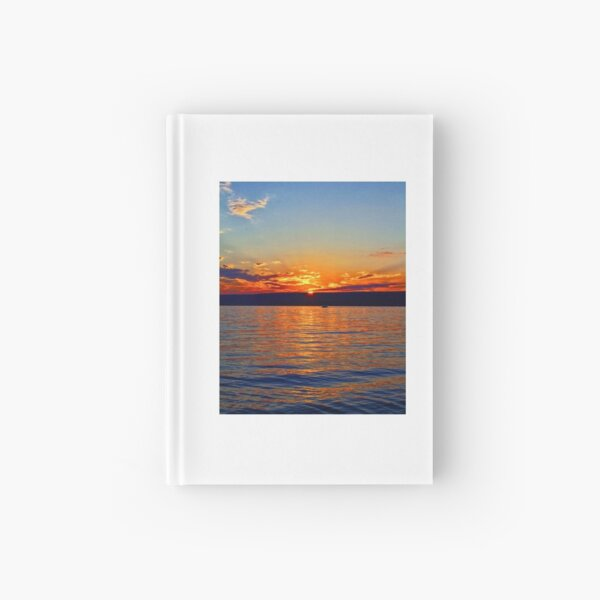 Sunset over the water Hardcover Journal