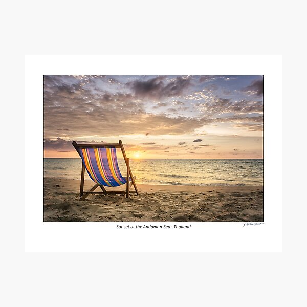 Empty deck chair at secluded beach during sunset, Andaman Sea, Thailand Photographic Print