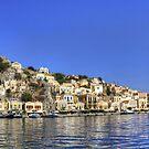 Across Symi Harbour by Tom Gomez