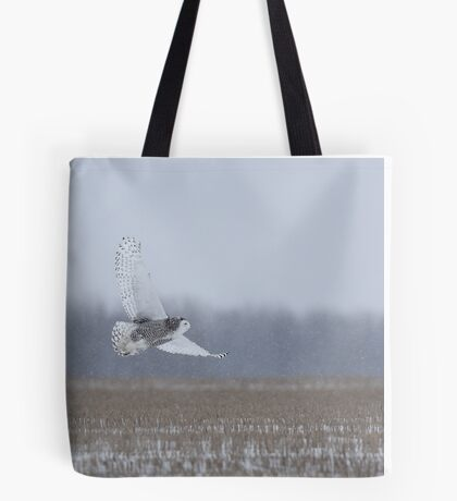 Snowy Owl takes flight Tote Bag