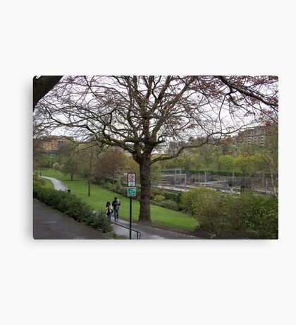 Couple walking on a wet path in Edinburgh near the Train Station Canvas Print