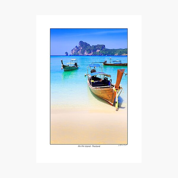 Typical Thai longtail boats in Dahlam Bay on Phi Phi Island, Thailand. Photographic Print