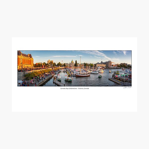 Canada Day in Victoria, Vancouver Island, Canada. Masses of people visiting the celebrations at inner harbour with the parliament building during sunset. Photographic Print