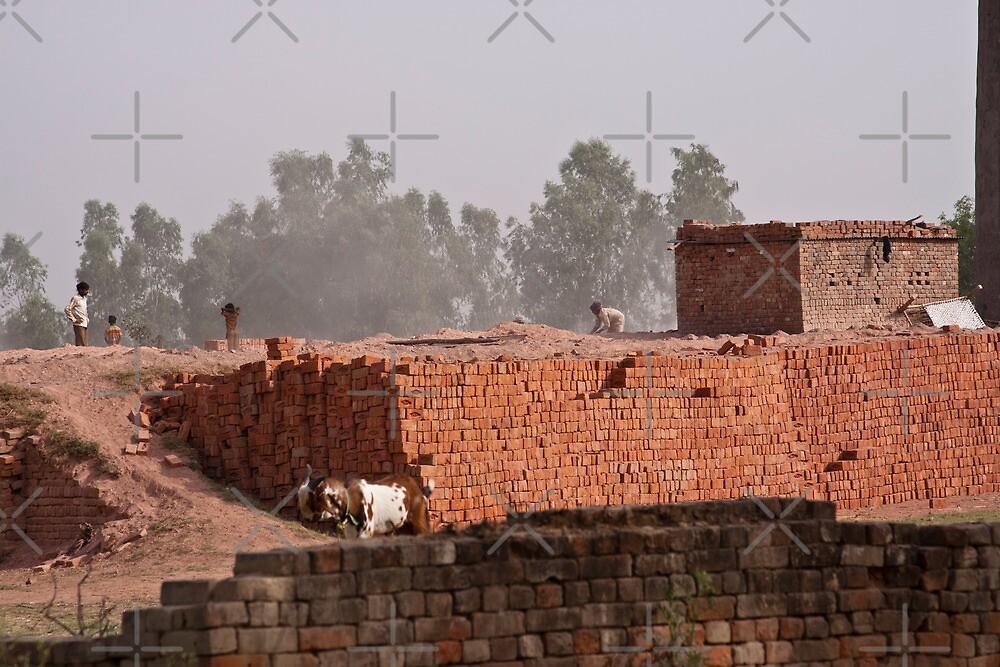 Workers at a brick kiln by ashishagarwal74