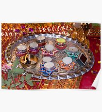 A decorated Hindu prayer thaali (bowl) with wax candles, oil lamps Poster