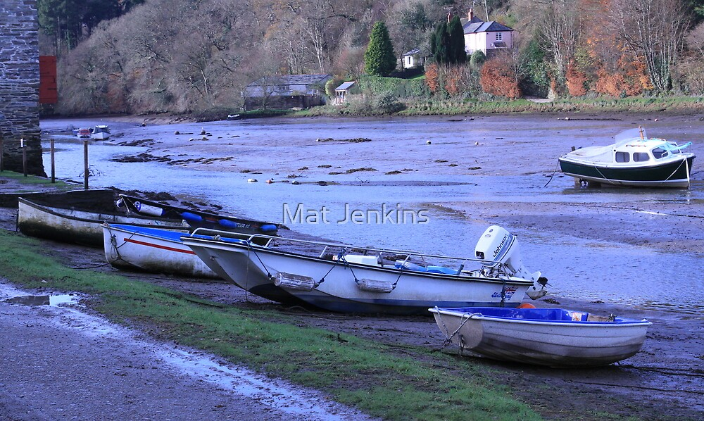 row of boats by Mat Jenkins