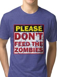 Don't feed zombies Tri-blend T-Shirt