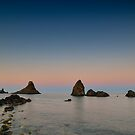 I faraglioni al tramonto by Andrea Rapisarda
