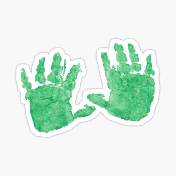 Pair of children hands in green paint. Sticker