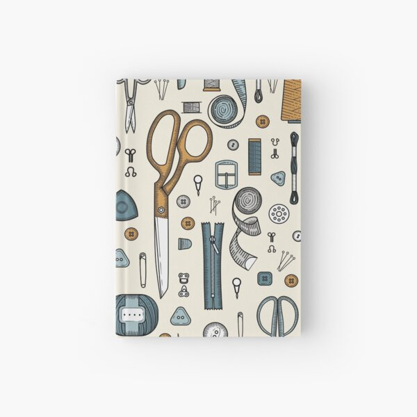 Handmade, sewing, embroidery, needlework items on a green background. Hardcover Journal