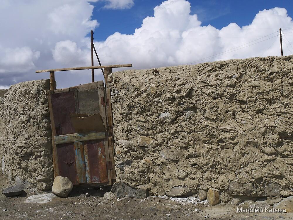 Small gate in a stone wall (Karakul) by Marjolein Katsma