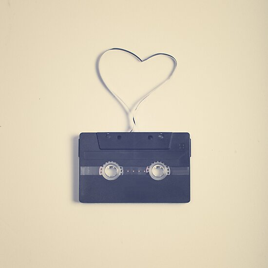 Music retro black cassette and tape heart shaped by Caroline Mint