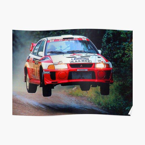 Tommi Mäkinen saltando en su auto Mitsubishi Evo World Rally Póster