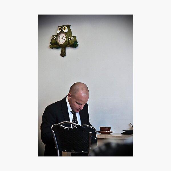 Man with owl clock Photographic Print