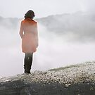 red coat in the ocean of fog by LauraZalenga