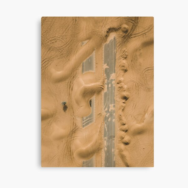 Dubai dessert road covered in sand Canvas Print