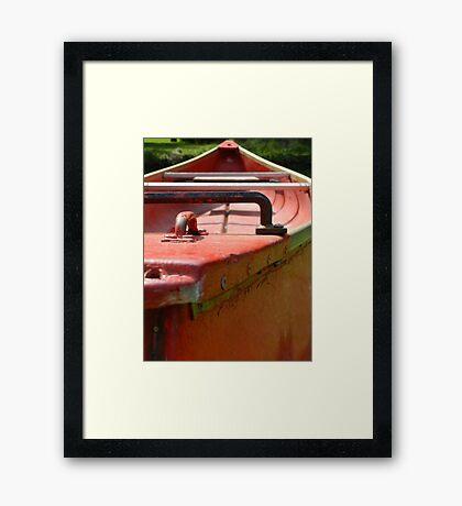 Red Canoe Framed Print