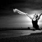 A ballerina in black an white on the beach by thermosoflask
