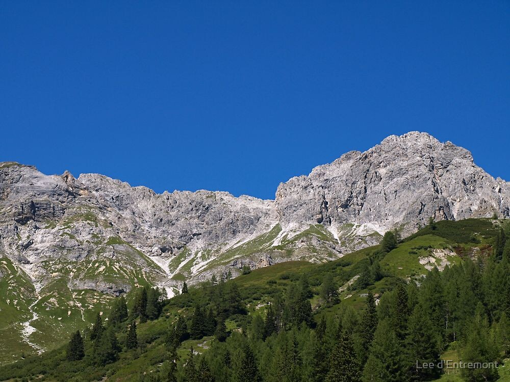 Cloudless day in the Austrian Alps. by Lee d'Entremont