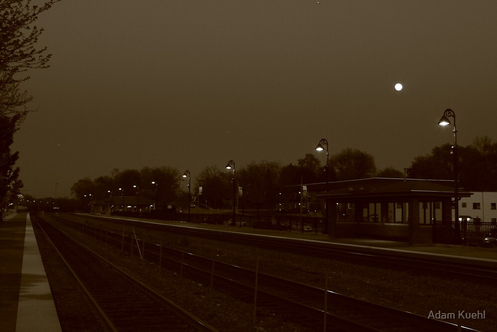Full Moon hangs over the Lisle, IL train station. by Adam Kuehl