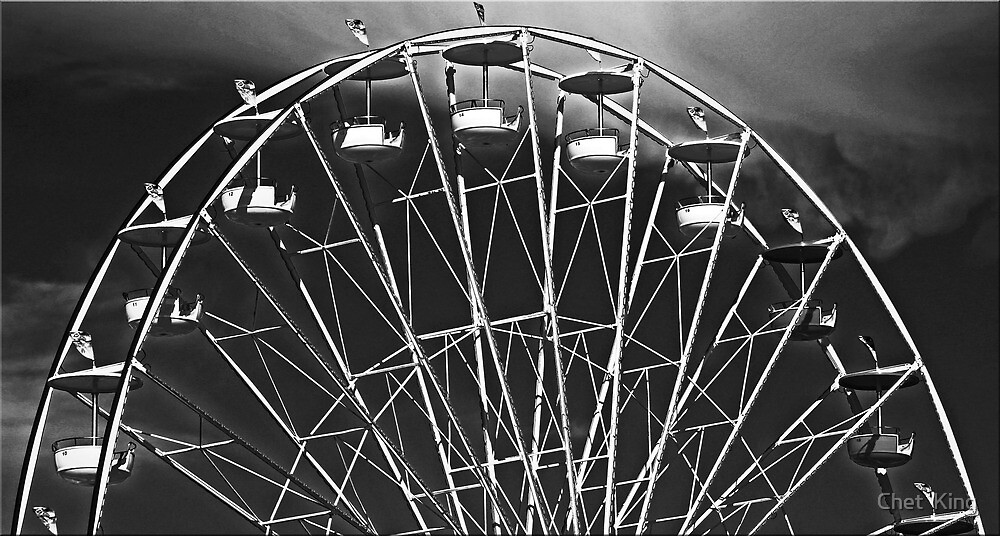 Wheel And Clouds by Chet  King