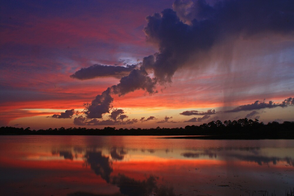 rain shower at sunset by cliffordc1