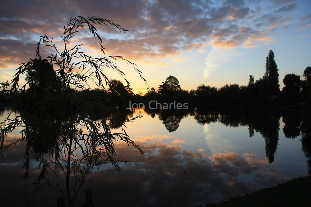 Sunset over Water by Jon Charles
