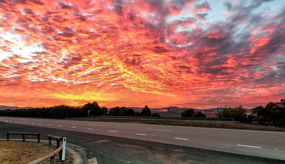 Sun Rise on the road  by Mark Bilham