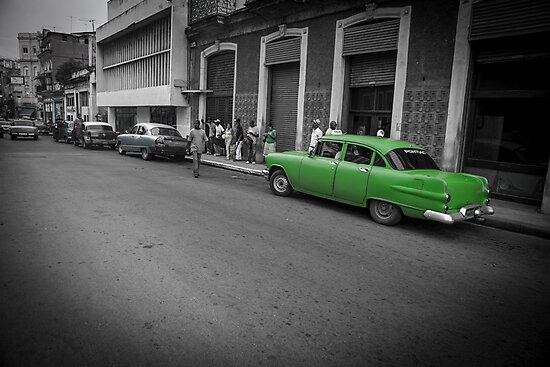 Green car in Havana street scene. by brians101