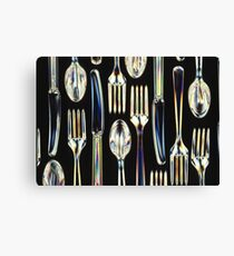 Plastic Knives, Forks and Spoons Arranged In A Pattern Canvas Print