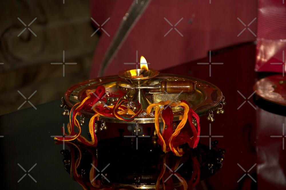 Lamp on a metal plate as part of a Hindu ritual by ashishagarwal74